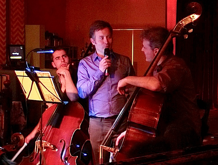 Conductor Simon Capet chats with bass player Jordan O'Conor about his arrangements of five Beck songs for Monday's concert at Lula Lounge (John Terauds phone photo).