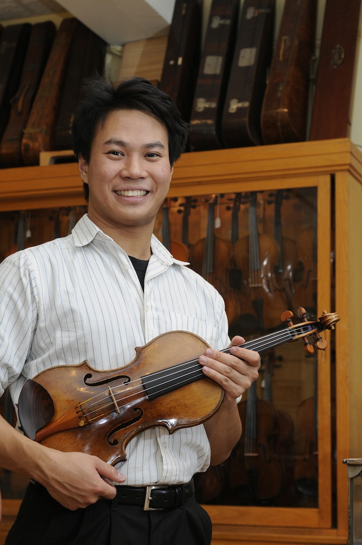 Nikki Chooi with his 1729 Guarneri del Gesù violin from the Canada Council instrument bank.