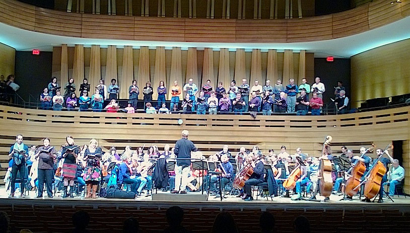Soloists Michael Adair, Michael Colvin, Krisztina Szabó and Shannon Mercer with the Toronto Mendelssohn Choir and orchestra rehearsing at Koerner Hall on Monday night (John Terauds phone photo).