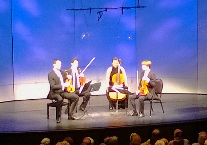 Jeffrey Myers, Ryan Meehan, Estelle Choi and Jeremy Berry of the Calidore String Quartet get ready to perform in Banff on Tuesday (John Terauds phone photo).