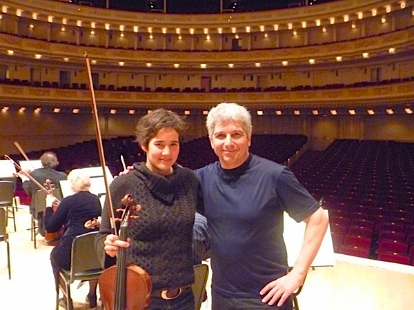 Musician and Classical 96 FM host Kathleen Kajioka with conductor Peter Oundjian during a Toronto Symphony Orchestra rehearsal break at Carnegie Hall in 2011 (Kathleen Kajioka photo).