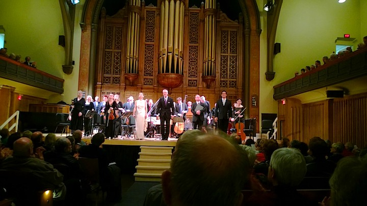 The singers and instrumentalists of Tafelmusik acknowledge applause at Jeanne Lamon Hall on Thursday night (John Terauds phone photo).