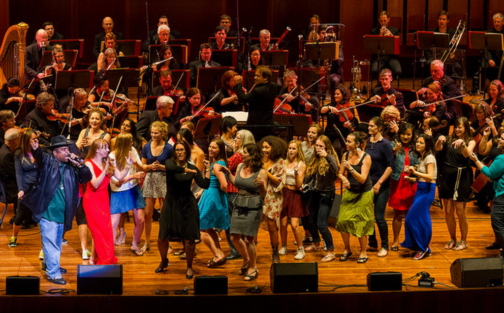 """Sir Mix-A-Lot, far left, performing """"Baby Got Back"""" with the Seattle Symphony. Credit: Ben VanHouten"""