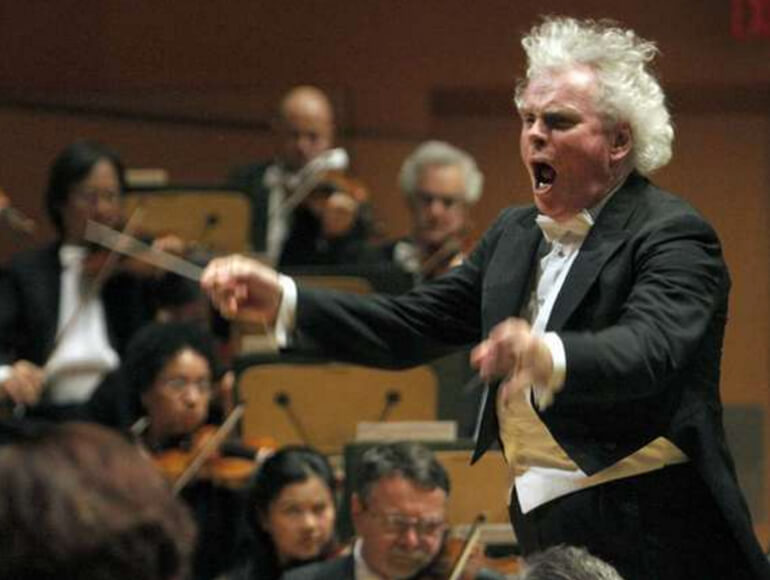 Simon Rattle conducts the Los Angeles Philharmonic at Walt Disney Concert Hall in 2012.