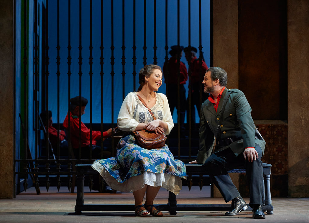 Karine Boucher as Micaëla and David Pomeroy as Don José in the Canadian Opera Company production of Carmen, 2016. (Photo: Michael Cooper)