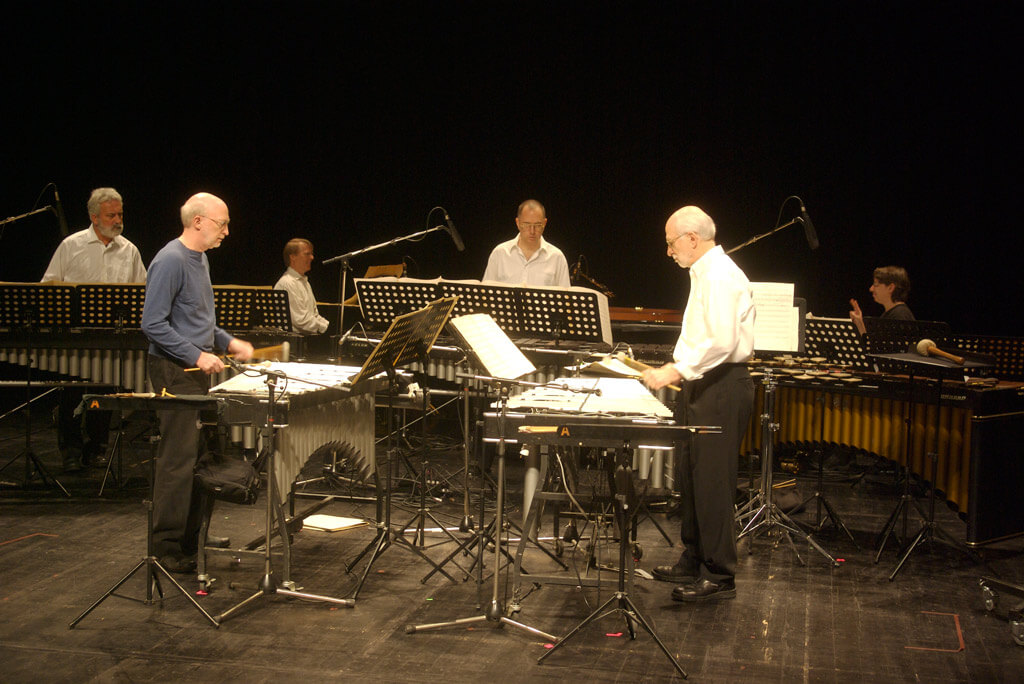 Steve Reich Ensemble rehearsing Sextet, Le Havre, France. From Left, Garry Kvistad, Bob Becker, Edmund Niemann, Thad Wheeler, Russell Hartenberger, and Nurit Tilles (Photo: Flickr.com)