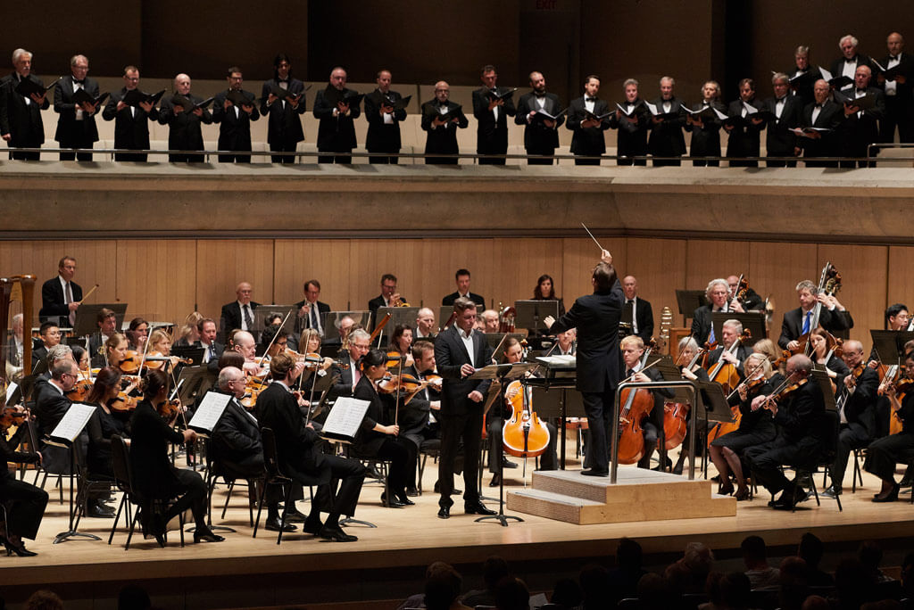 Petr Migunov, Andrey Boreyko, the TSO & Men from the Amadeus Choir and the Elmer Iseler Singers. (Photo: Malcolm Cook)
