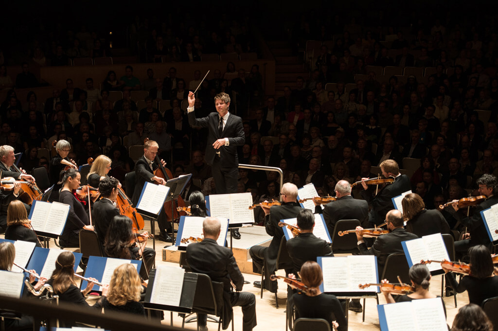 Guest conductor Krzysztof Urbanski with the TSO (Photo: Jag Photography)