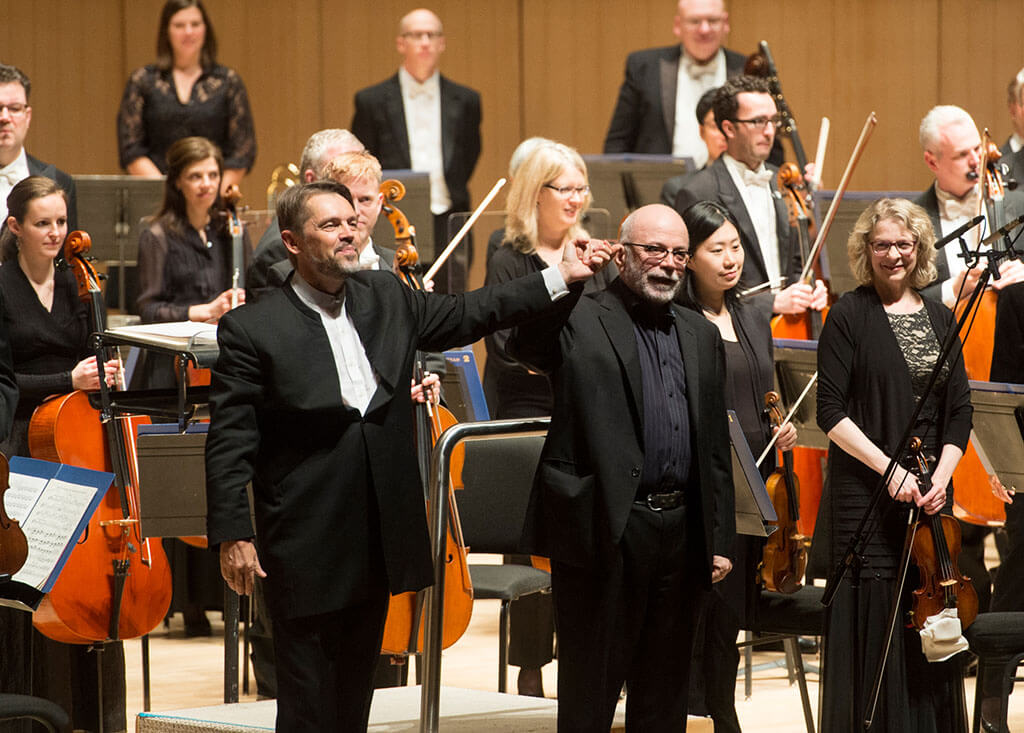 Conductor Andrey Boreyko and composer Christos Hatzis take a bow after his evocation of Shakespeare's The Tempest (Photo: Jag Gundu)