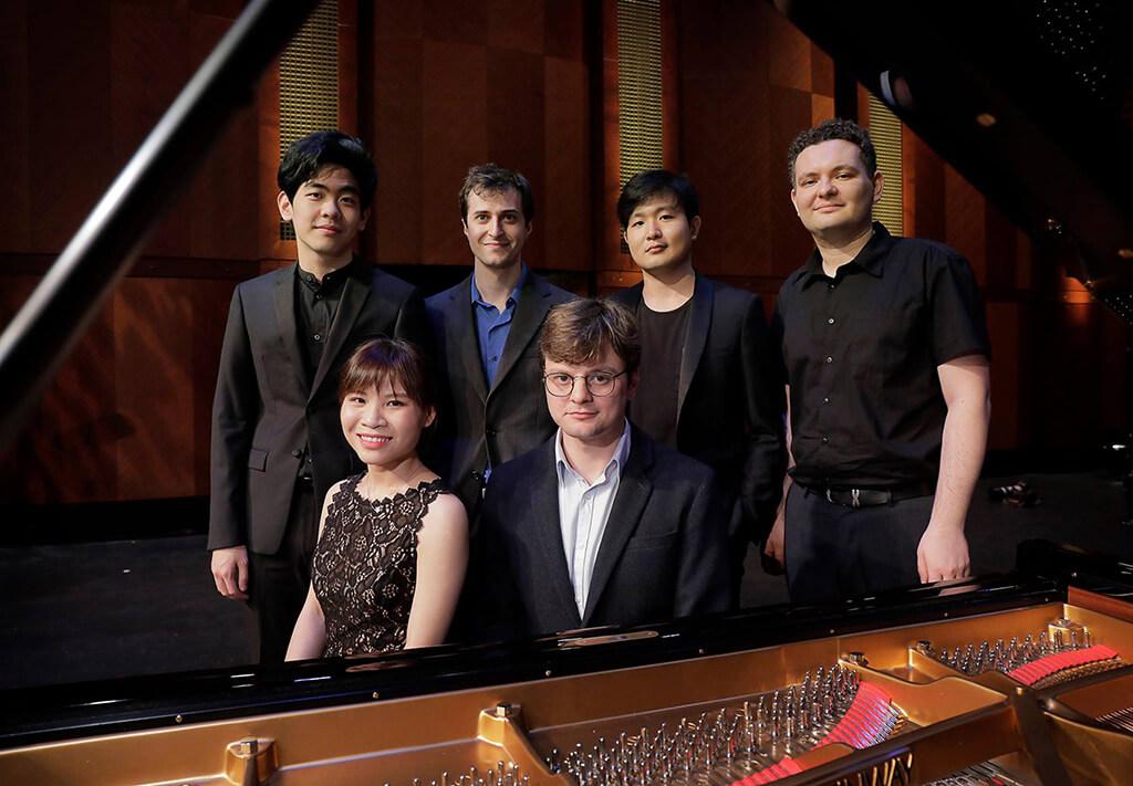 Finalists of the Fifteenth Van Cliburn International Piano Competition. Seated: Rachel Cheung, Georgy Tchaidze; Standing, l-r: Daniel Hsu, Kenneth Broberg, Yekwon Sunwoo, Yury Favorin (Photo: Ralph Lauer/The Cliburn)