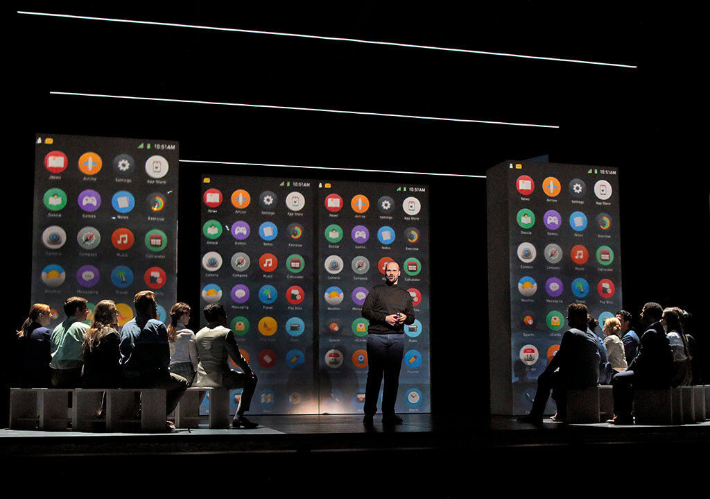 Edward Parks (Steve Jobs) and the Santa Fe Opera Chorus (Photo Ken Howard)