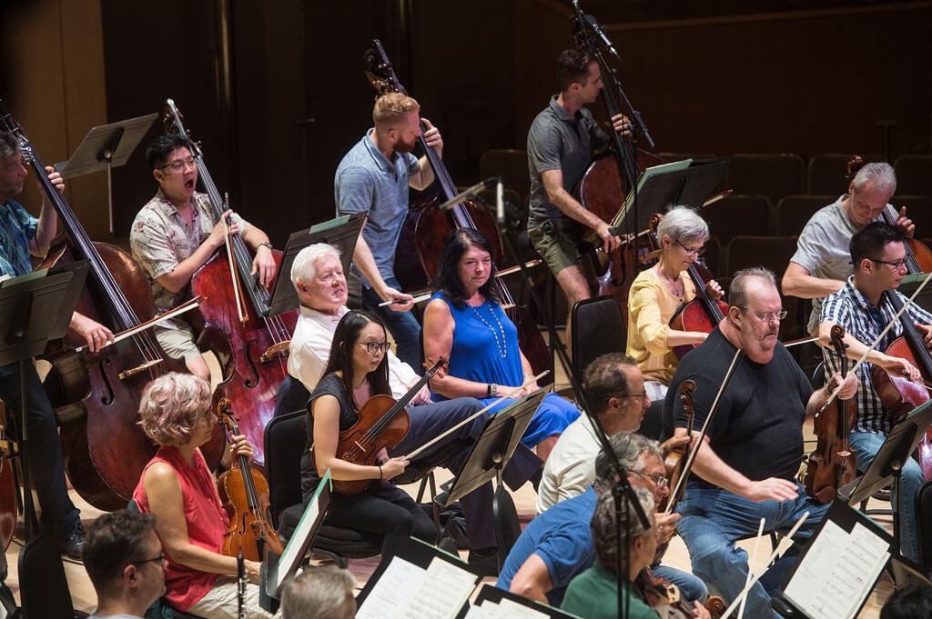 Bob and Arlene Perly Rae sit beside TSO musicians during a rehearsal (Photo: Jag Gundu)