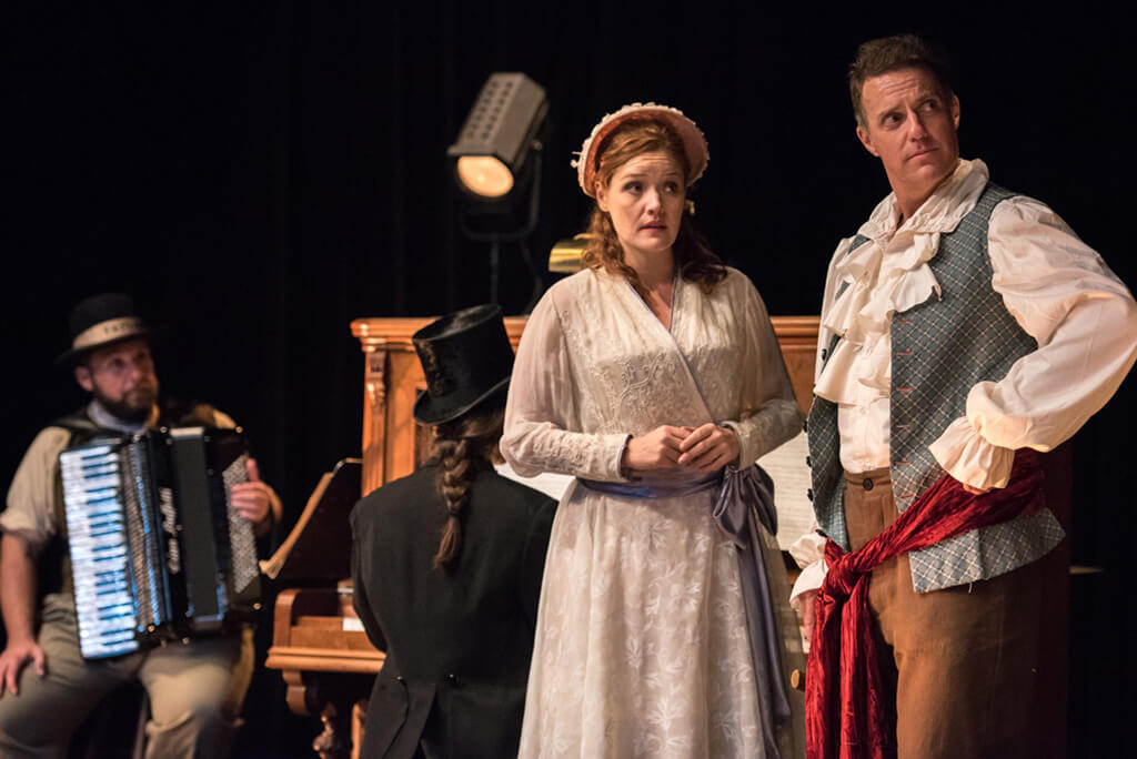 Jacques Arsenault (background), Jennifer Taverner, and Keith Klassen in Bandits in the Valley, Tapestry Opera, 2017. (Photo: Dahlia Katz)