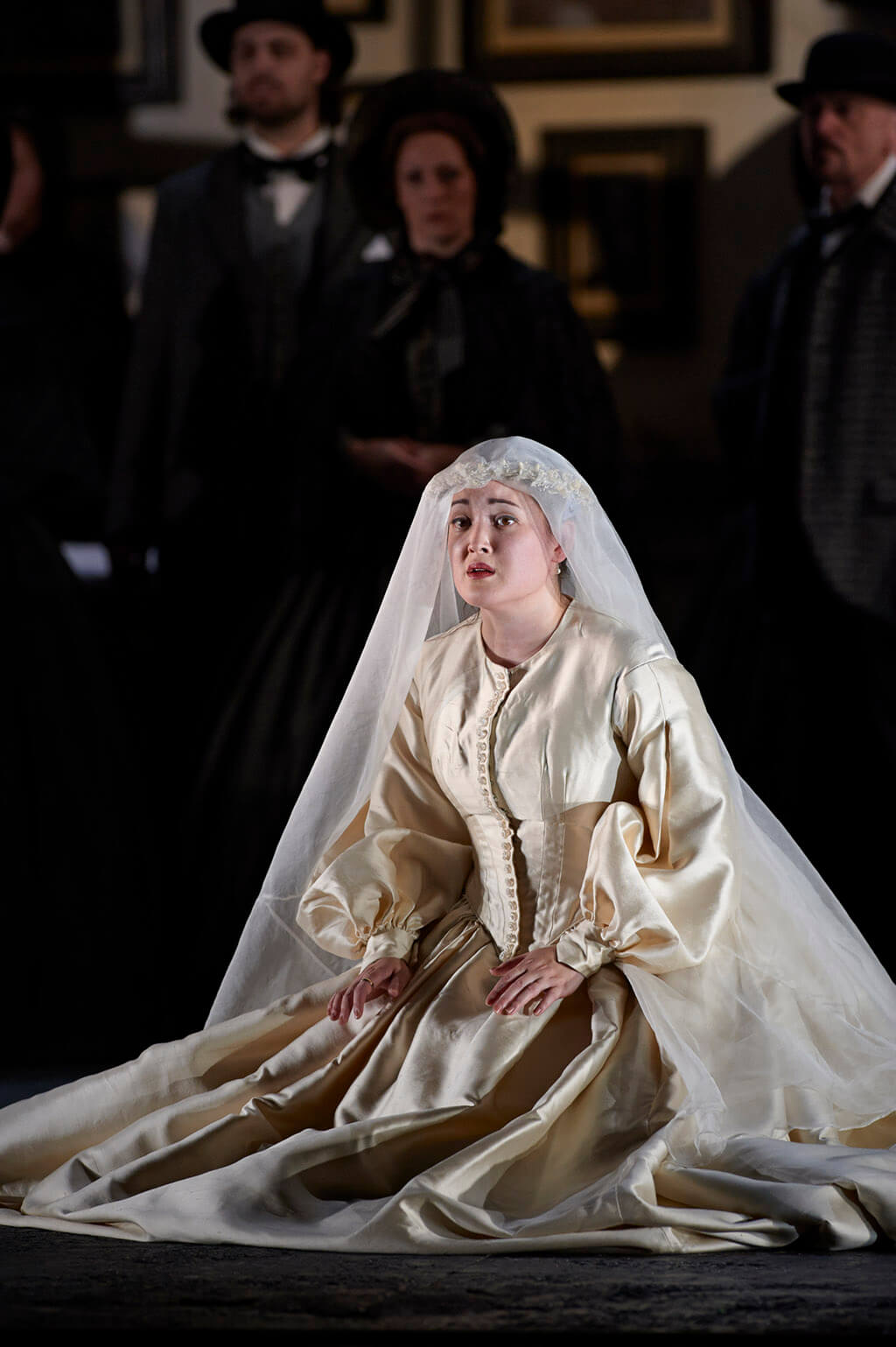 Anna Christy as Lucia in the Canadian Opera Company's production of Lucia di Lammermoor, 2013. Conductor Stephen Lord, director David Alden, associate director Ian Rutherford, set designer Charles Edwards, costume designer Brigitte Reiffenstuel, original lighting designer Adam Silverman and lighting design re-creator Andrew Cutbush. (Photo: Michael Cooper)