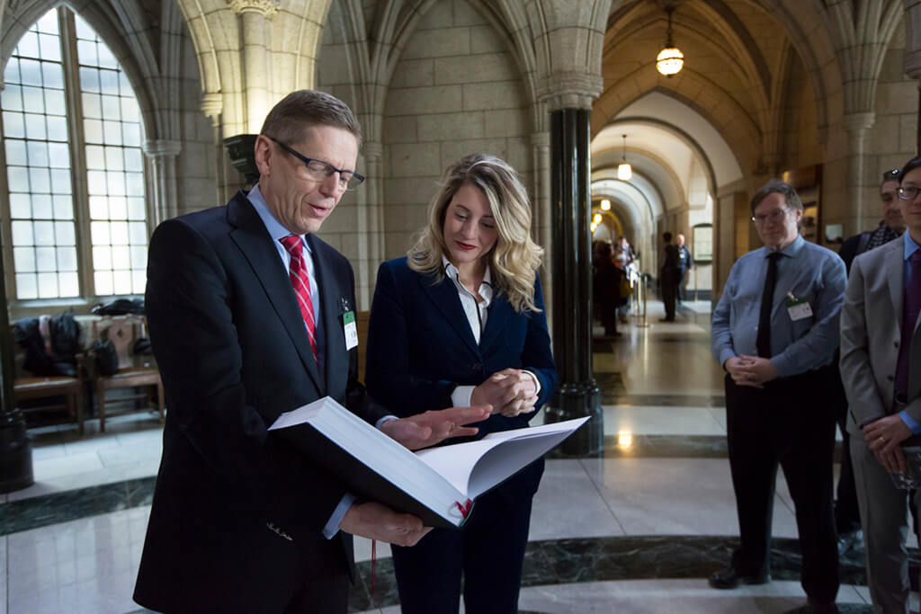 The Toronto Symphony Orchestra presented Heritage Minister Melanie Joly with a book of songs and a CD from last year's Canada Mosaic project, on Parliament Hill in Ottawa, Ontario on Feb 13, 2018. (Photo: David Kawai)
