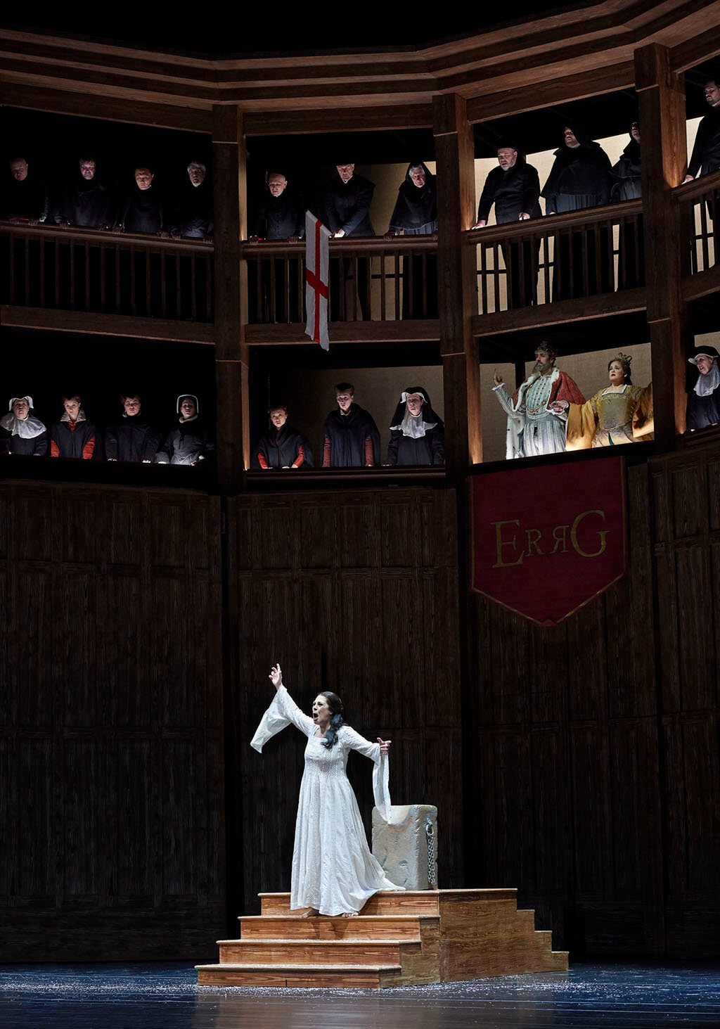 Sondra Radvanovsky as Anna Bolena (centre) with Christian Van Horn as Enrico VIII and Keri Alkema as Giovanna Seymour (above banner) (Photo: Michael Cooper)