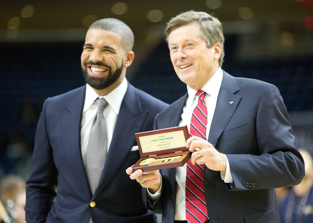 Rap star Drake accepts the key to the city from Toronto Mayor John Tory in 2016.