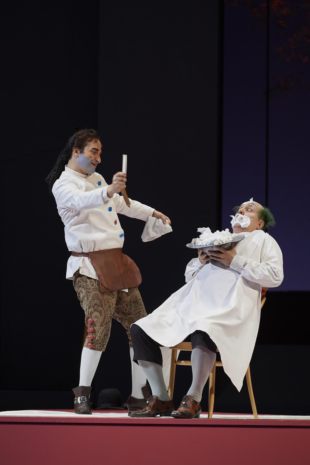 (l-r) Vito Priante as Figaro and Renato Girolami as Bartolo in the Canadian Opera Company's production of The Barber of Seville, 2020, (Photo: Michael Cooper)